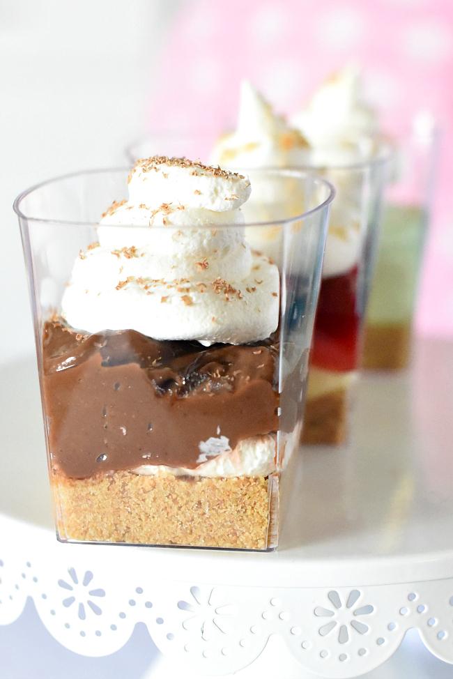 at our bridal shower we served strawberry shortcake cheesecakes topped with cherries chocolate mousse and a pistachio pudding mousse these mini desserts